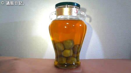 プラムトニック梅申(ばいしん)ガラス壺に入った黄金色の梅酒。